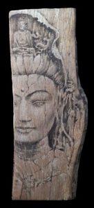 visage de Bouddha sur bois massif