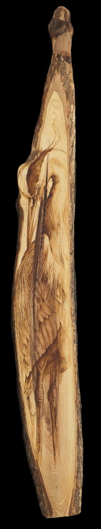 Héron sur bois